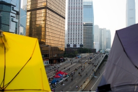Harcourt Road, viewed through two umbrellas fastened to a pedestrian overpass, remains closed to traffic as protestors continue to camp out overnight. In the 10th day of #OccupyCentral protests, the number of protestors have now dwindled down to 1000. (Photo: Adam McCauley)
