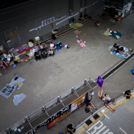 Supporters of #OccupyCentral rest with friends and on their own, adjacent Harcourt Road in central Hong Kong on October 7, 2014. (Photo: Adam McCauley)