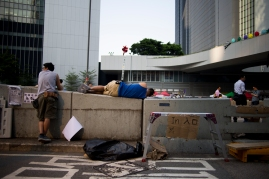 A protestor enjoys an afternoon nap on the cement median on Harcourt Rd in Hong Kong, site of the #OccupyCentral demonstrations which began on September 26, 2014. (Photo: Adam McCauley)